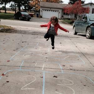 Amelia learning hopscotch